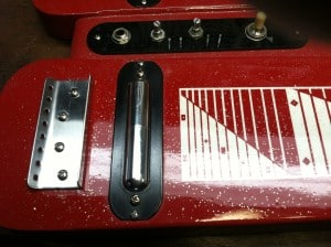 A Clean Red Morrell Lap Steel without strings