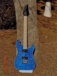 A beautiful hand-built blue electric guitar, with flaming top