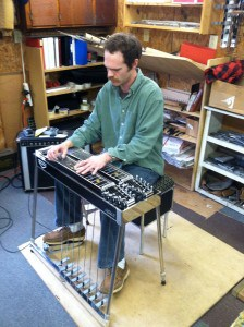 Playing a Black Emmons LeGrande II pedal steel guitar at Billy Knowles' shop